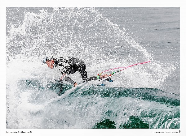 A surfer performs a Throwing The Fins Out maneuver