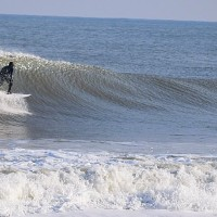 Goofy footer stoke left. United States, Surfing photo