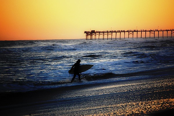 Surifng during Sunset. United States, Surfing photo