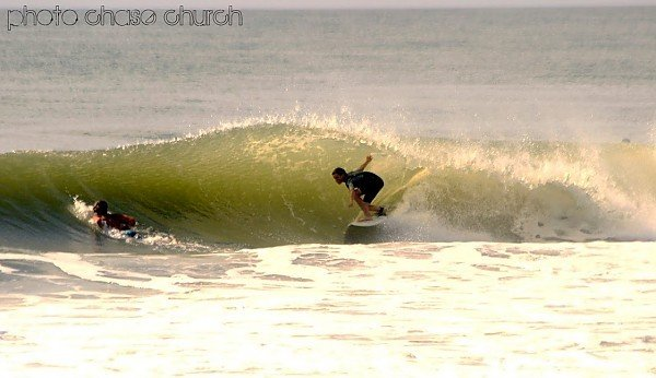 Noah Conboy in a summertime barrel