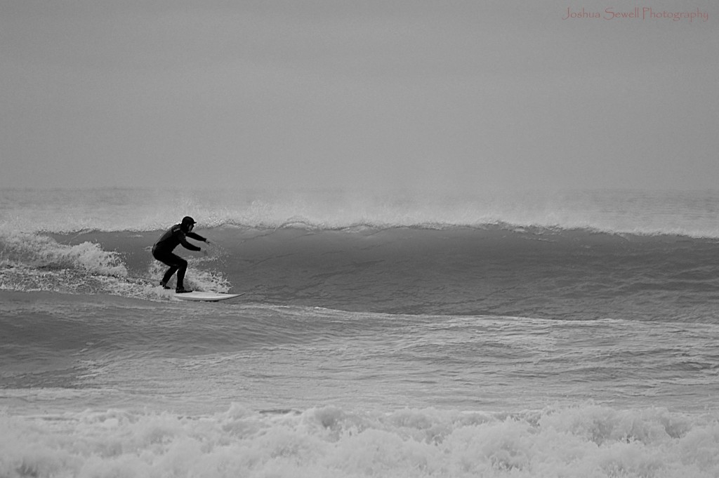 Ray Harris Jr. surfing on a cold North Carolina day.