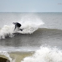 Owen Moffet surfing on a cold North Carolina Day