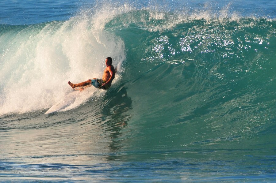 Description. Pt. Panic, Oahu, surfing photo