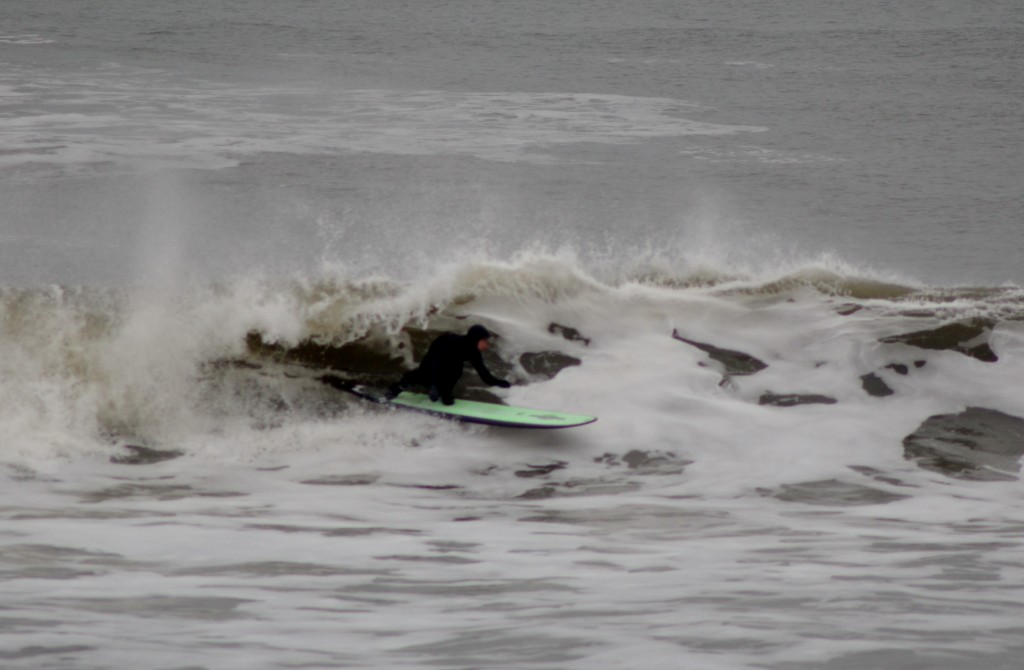 Kevin DeWald going left. New Jersey, surfing photo