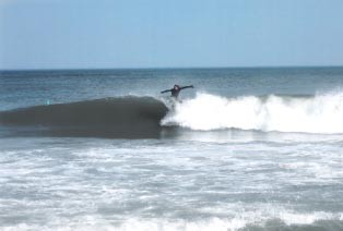 Conor with the late drop. Delmarva, surfing photo