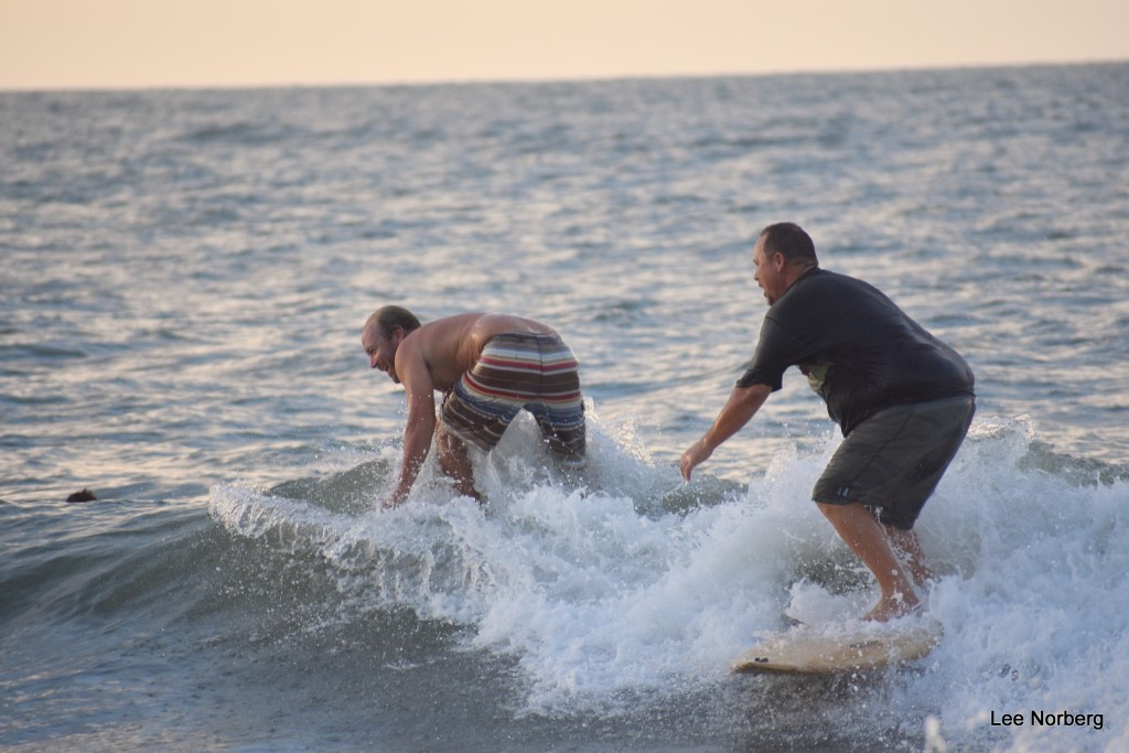 Local Surfers Justin Wood and Don Ward both try to