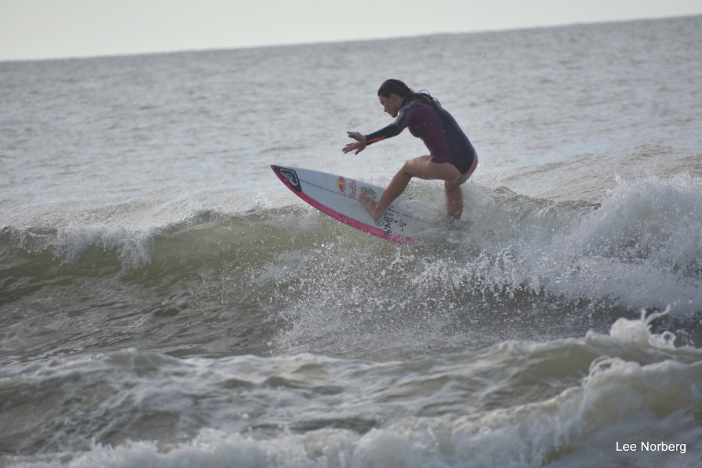 Young Lady Surfer really shows er skills on the crest