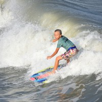 Young Surfer is looking to cut left on the Wave,