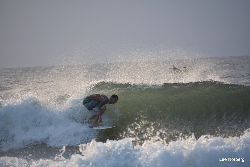 Shawn ducks under the Wave.. South Carolina, Surfing photo
