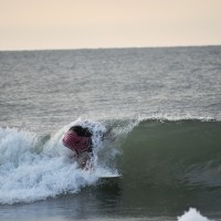 "Local Surfer ""Sean"" enters the curl of the Wave."
