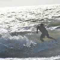 Local Surfer Justin Wood rides out a Wave at Sunrise