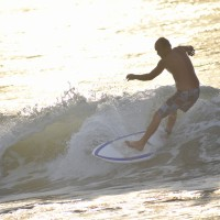 Another Local Surfer rides a Wave at The Rocks.