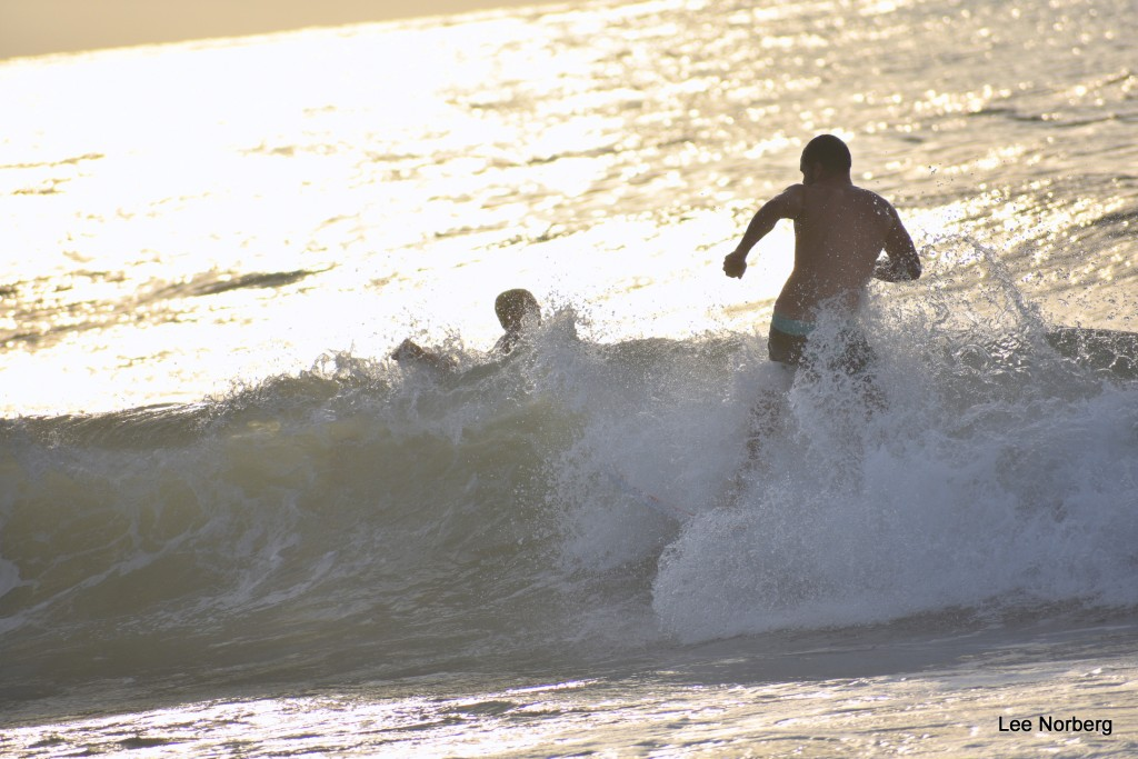 Justin rides a Wave at Sunrise.