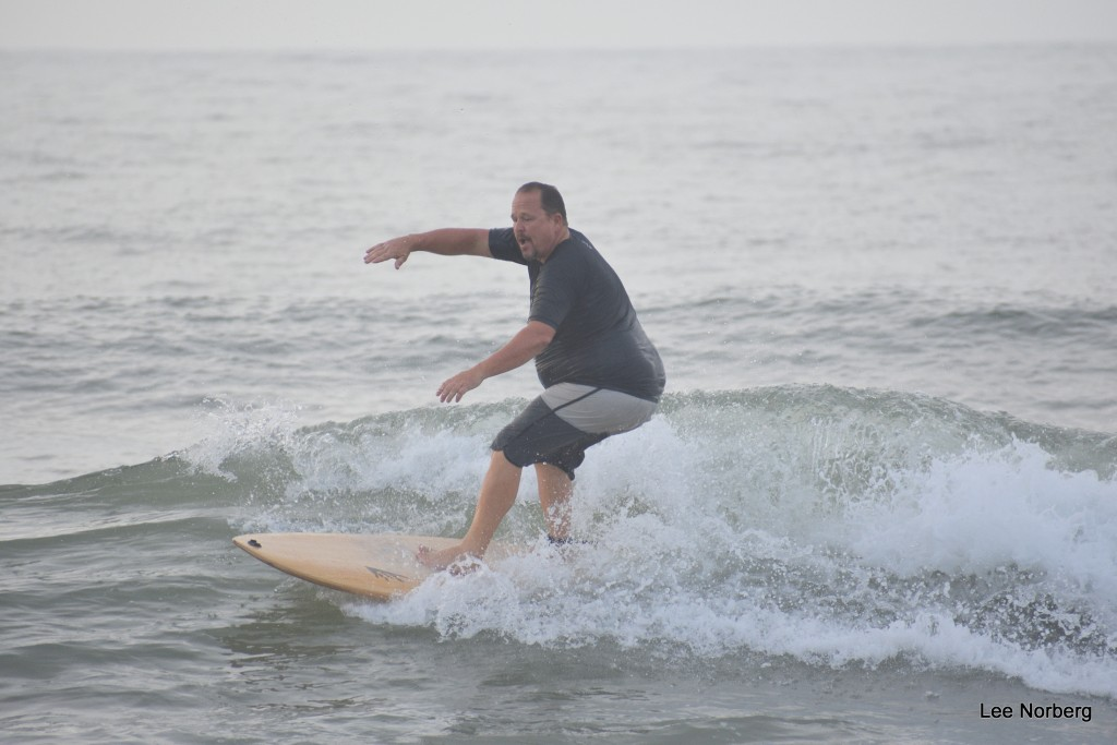 Local Surfer Don rides it out at The Rocks.