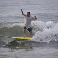 Local Surfer Steve Patello rides the Curl on his Long