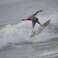 Local Surfer Shawn Clark performs a reverse cut at
