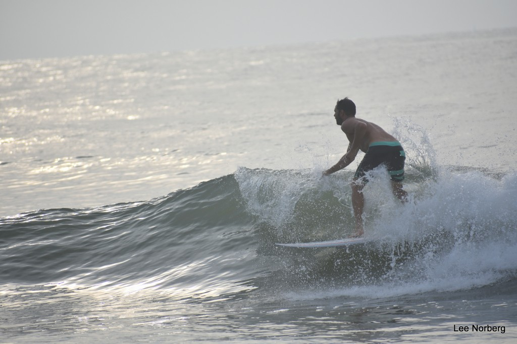 Local Surfer Terry Coggins rides in the Curl at The