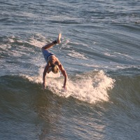Young Surfer goes airborne after kick-out on a Wave.