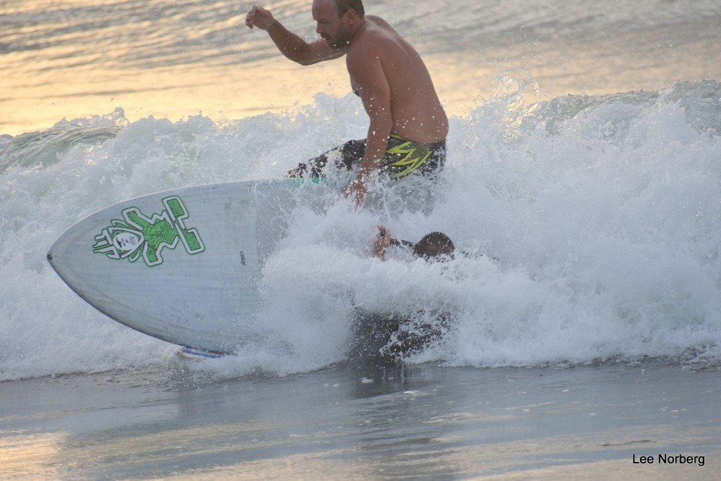 Surfers Justin and Don are close to a collision on