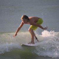 Young Surfer Austin rides a Wave.