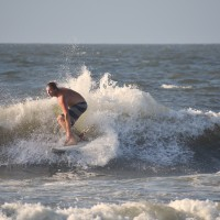 Surfer walks the nose of the board to gain speed ahead