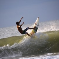 Shawn Clark really climbs a Wave in this Image at The