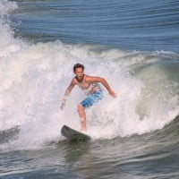 Young Surfer is readying his next move on the Wave.
