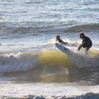 Local Surfer Pete Hansen rides the crest of a Wave