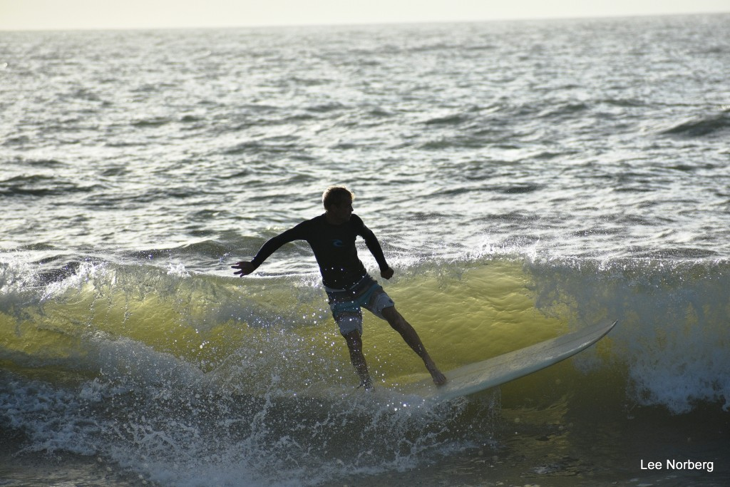 Local Surfer Scott Nixon rides the crest of a Wave