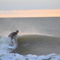 Surfer Shawn Clark getting in the curl of a Wave at