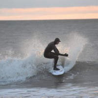 Surfer Shawn Clark works a Wave at Sunrise on a cold