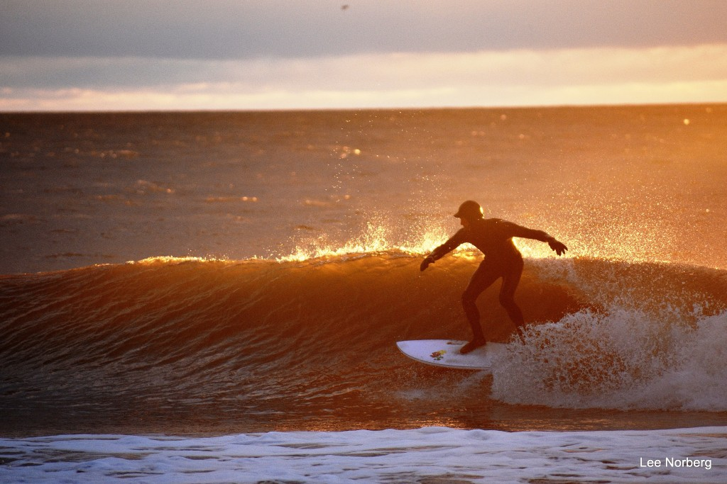 At Sunrise on a cold Morning Surfer Shawn Clark cuts