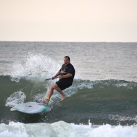 Local Surfer Don on the Paddle Board if fighting to