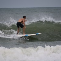Surfers showing their moves at Garden City Beach Access