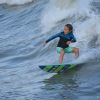 This young Surfer is setting up a turn across the Wave,