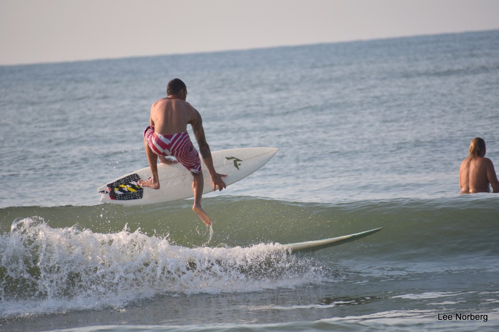 Local Surfer Sean jumps off Long Board to Short Board,