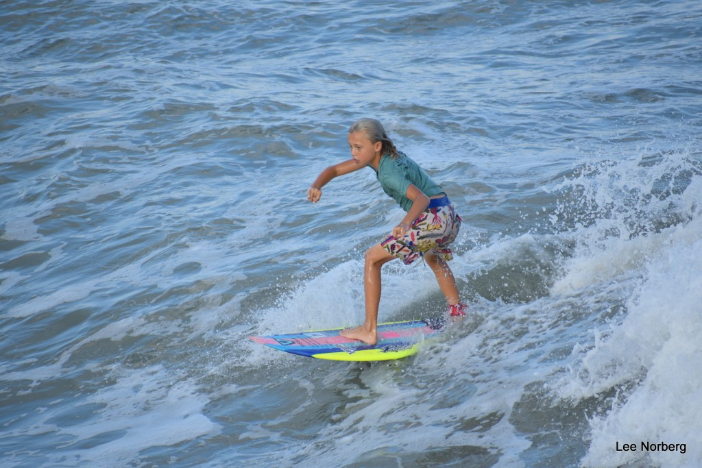 Young Surfer rides out the Wave.