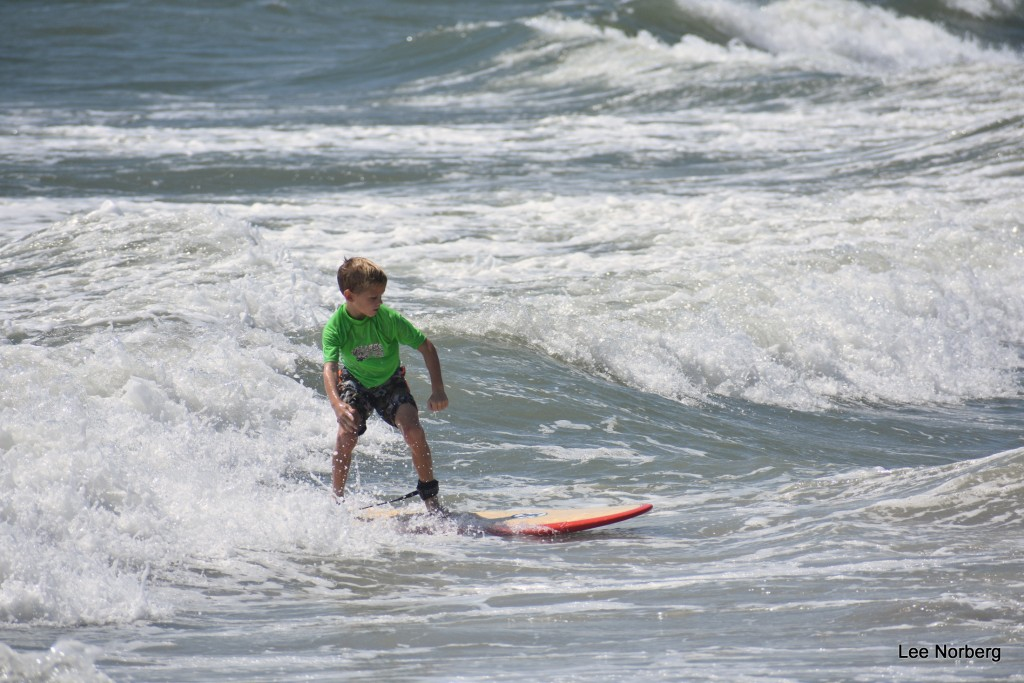 Young Surfer shows good form on the Board.