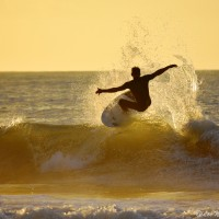 """Surfer Sunrise Greeting"", Surfer greets a new day"