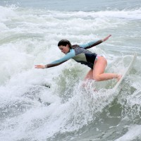 Bree Labiak working a Wave at Garden City Beach Pier,