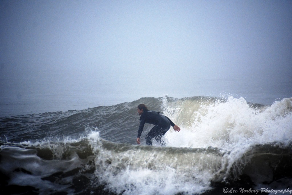 Surfer John Hammel is riding between Wave Peaks at
