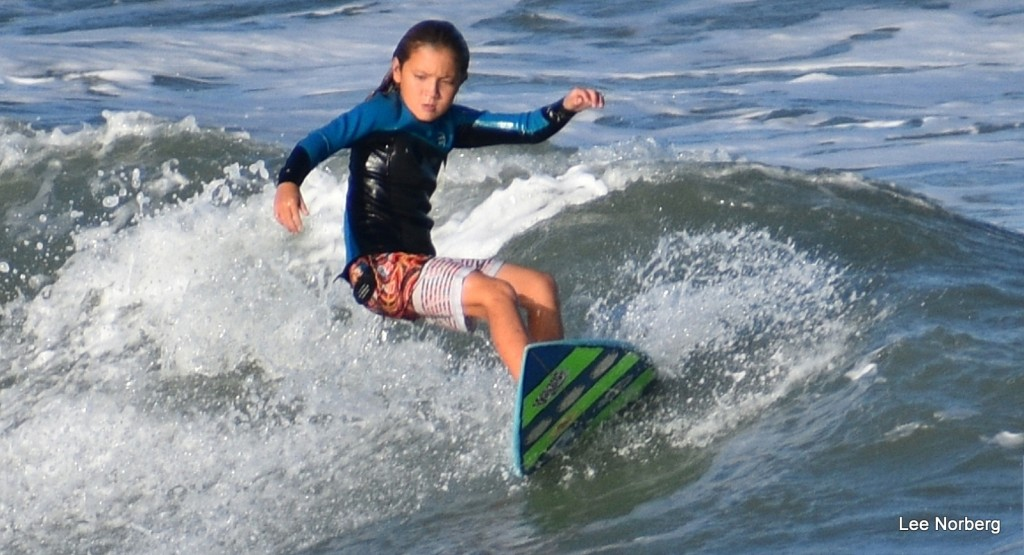 Young Surfer cuts back against the wave in late afternoon