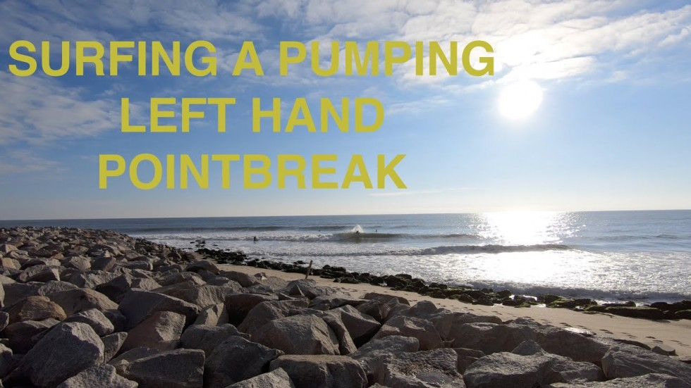 SURFING A PUMPING LEFT HAND POINTBREAK